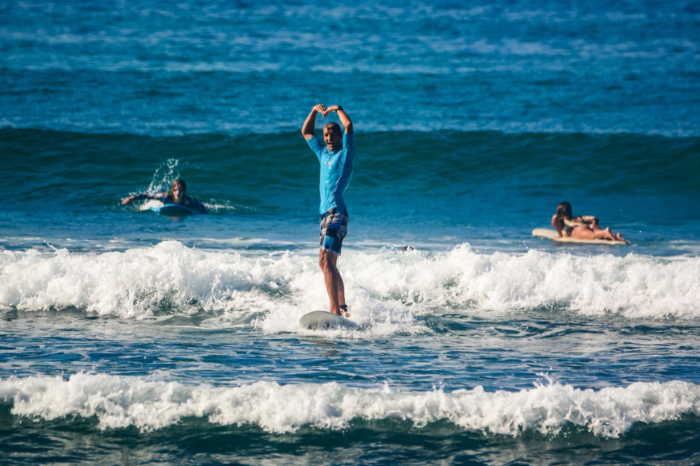 guy surfs small waves in sri lanka